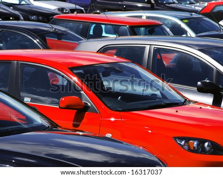 Telephoto view of cars parked in parking lot - stock photo