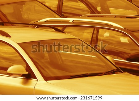 Telephoto view of cars parked in parking lot (toned brown) - stock photo