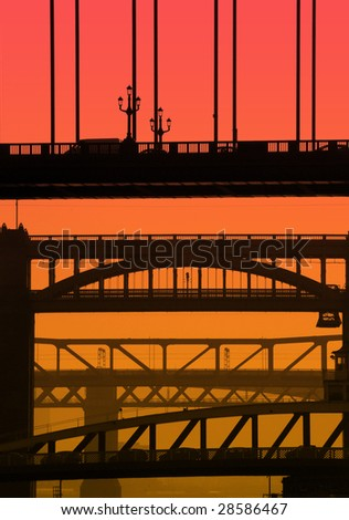 Telephoto view of Newcastle/Gateshead bridges overlaid with red/orange color for effect. - stock photo