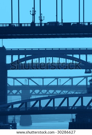 Telephoto view of Newcastle/Gateshead bridges with blue color added. - stock photo