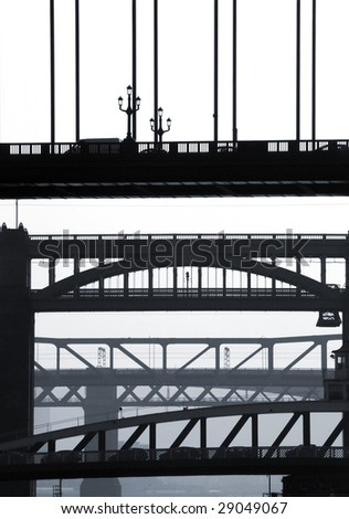 Telephoto view of the bridges crossing between Newcastle and Gateshead - stock photo