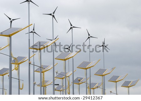 Telephoto view of wind and solar power generators - stock photo