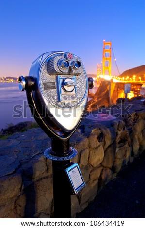 Telescope at Golden Gate bridge at night - stock photo