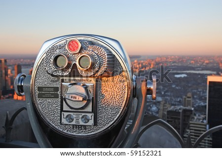 Telescope for sightseeing at sunset - stock photo