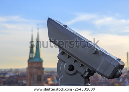 Telescope in the Nuremberg castle, view of the city, church, sky, clouds  - stock photo