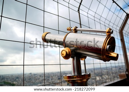 Telescope on Eiffel tower - stock photo