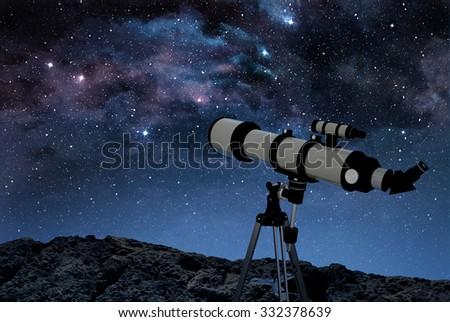 telescope on rocky ground observing a starry night sky - stock photo