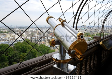 Telescope on top floor of Eiffel Tower in Paris, France. Useful file for your brochure, flyer or website about France sightseeing. - stock photo