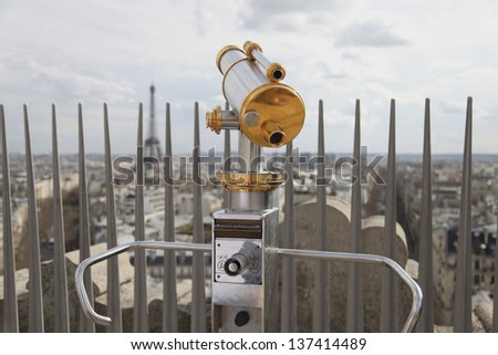 Telescope overlooking  for Paris. View for Eiffel tower