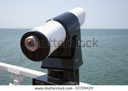 telescope overlooking water