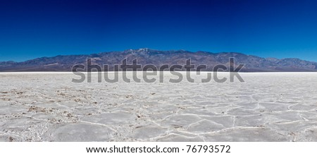 Telescope Peak rises up from the salt floor of Death Valley's lowest point. - stock photo