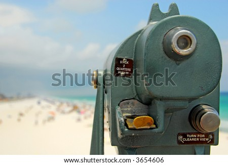 Telescope Viewfinder Overlooking Crowded Beach - stock photo