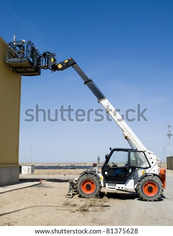telescopic loader on work - stock photo