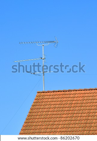 Television and radio antenna on the roof tile