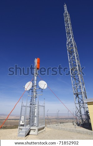 television and radio repeater with a clear blue sky