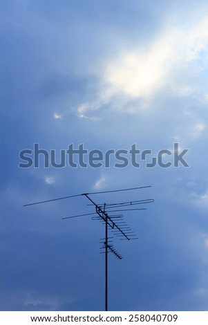 television antennas with a cloudy sky background - stock photo