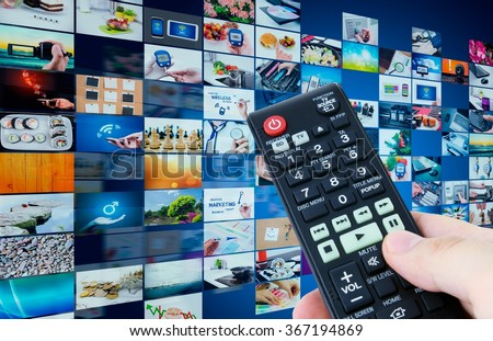 Television broadcast multimedia abstract composition with remote control - stock photo