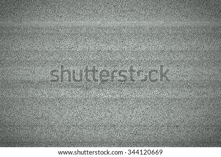 Television monitor grainy white noise signal background texture