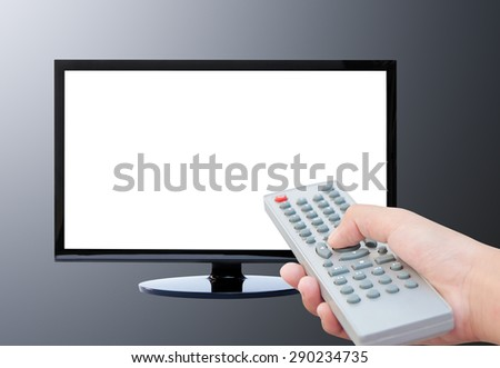 Television on wood floor and remote control TV  - stock photo