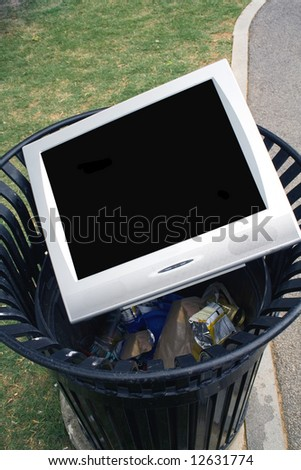 Television or Monitor laying in a trash can