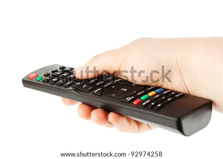 Television receiver Remote controller in a hand on the white - stock photo
