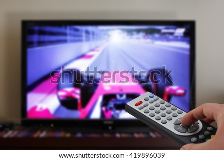 Television remote control in a car race, zapping