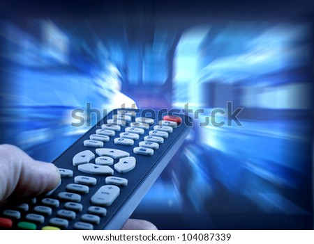 Television remote control  watching tv - stock photo