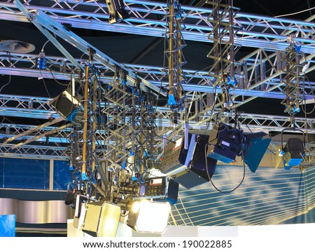 Television studio light equipment, spotlight truss, cables,  microphones and so on - stock photo