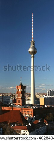 Television tower and townhall Rotes Rathaus at square Alexanderplatz in Berlin, Germany - stock photo