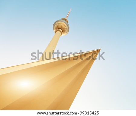 television tower in berlin mitte with blue sky (Fernsehturm Berlin), famous landmark in Berlin Germany - stock photo