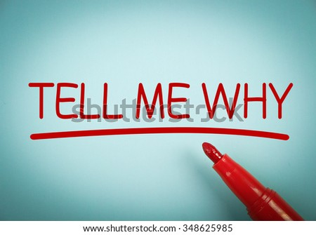 Tell Me Why text with red underline is written on blue paper. - stock photo