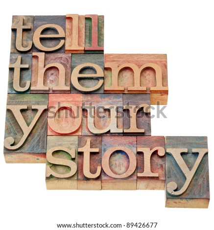 tell them your story - advice in isolated vintage wood letterpress printing blocks - stock photo
