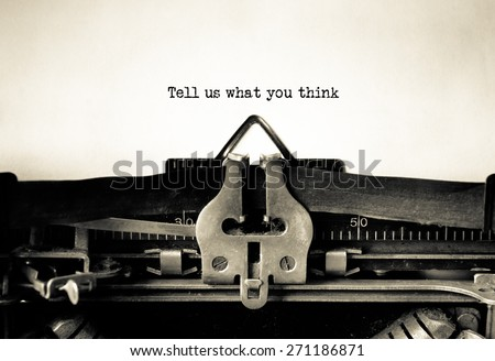 Tell us what you think message typed on vintage typewriter  - stock photo