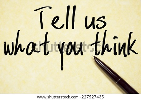 tell us what you think text write on paper  - stock photo
