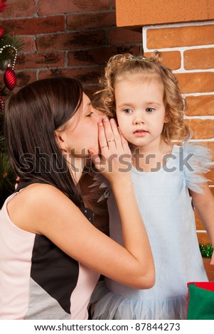 Telling a secret - stock photo