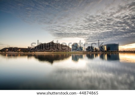 Tempe Town Lake with downtown tempe, A mountain, and a stadium visible. - stock photo