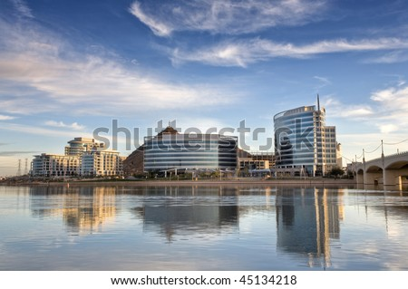 Tempe Town Lake with downtown Tempe in the background. Near Arizona State University and the Mill Avenue District. - stock photo