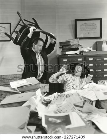 Temper tantrum at the office - stock photo