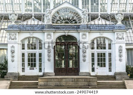 Temperate House (1859, designed by architect Decimus Burton) in the grounds of Kew Gardens. Richmond, London, England. - stock photo