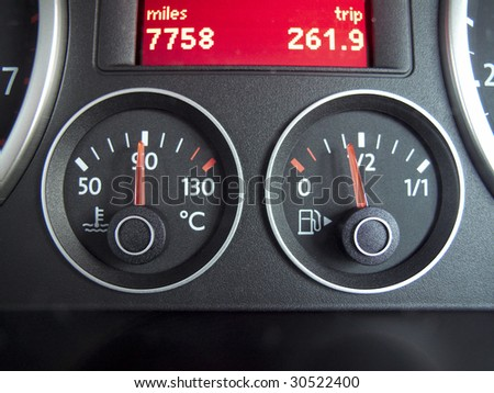 temperature and fuel gauge from a car dashboard