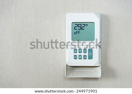 Temperature controller on the wall. - stock photo