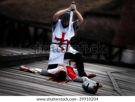 Templar killing his opponent - stock photo