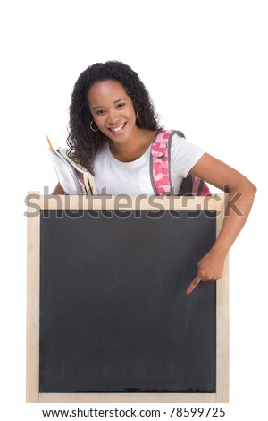template - Friendly ethnic black woman high school student by chalkboard promoting education - stock photo