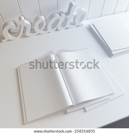Template of blank open magazine, some closed magazines and 3d word create on the table. - stock photo