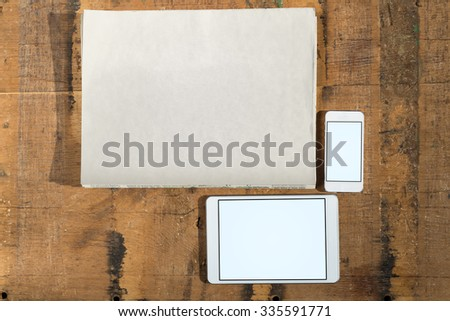 Template of daily newspaper issues and tablet and smart phone on wood  - stock photo