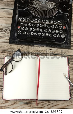Template preparation new storyteller job work .  Workplace writer journalist blog editor. Top view.  Vintage typewriter, glasses and notepad for notes on the wooden table. View top from above.  - stock photo