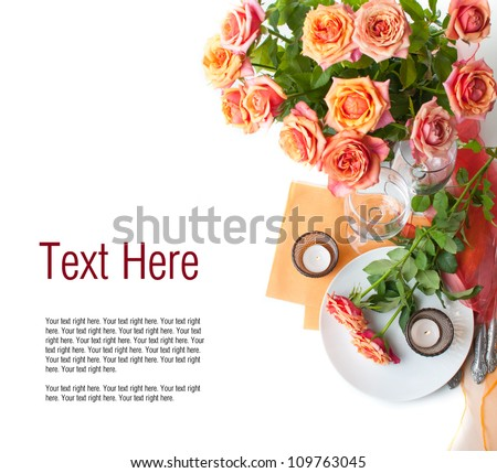 Template with festive table setting with roses and candles in shades of orange on a white background - stock photo