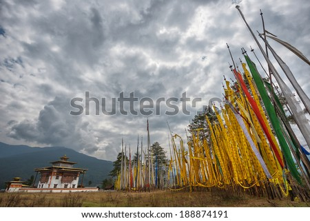 Temple and religious prayer flags in Bumthang valley, Bhutan - stock photo