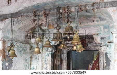 Temple bells in a Hindu temple in India, people ring bells before offering prayers to the gods, it is believed that sound of temple bells helps in emptying the thoughts of mind - stock photo