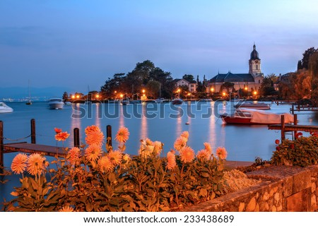 Temple de Morges as seen at twilight from the Quai Igor-Stravinsky in Morges, Switzerland on the shores of Lake Geneva (Lake Leman). - stock photo